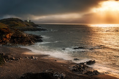 Bracelet Bay (Geoff Moore UK) Tags: stormclouds breakingwaves roughseas stormyweather morningsunlight newdaybreaking sunshineaftertherain coastalphotography braceletbaymumbles sunrays pebblebeach rockycoastline lighthouse