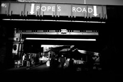IMG_9530 (1) (JetBlakInk) Tags: brixton brixtonmarket streetmarket railwaybridge popesroadmarket lowkey streetphotography composition mono lightandtone streetscene