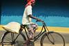 Reality in Motion. (Gattam Pattam) Tags: cycle india village rural gariyaband bastar chhattisgarh wall cob mud paint sun light pattern colour man motion