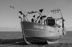 Fishing boat on Hastings Beach... (markwilkins64) Tags: hastings beach pebbles flags seagull fishingboat boat sea sky bw blackandwhite monochrome mono sussex rx150 fishingnets