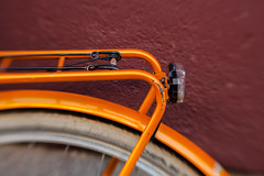 A Bit of Color to Brighten Things Up (suzanne~) Tags: 100bicycles colorful detail project bicyclerack wheel tire rim mudguard munich germany lensbaby