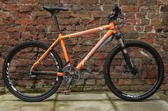 Sunday Service (Rob Pitt) Tags: orange mountain bikes g2 bike wheel outdoor tire bicycle seat 2012 orangeg22012 brick wall