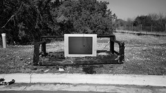 Burnt out (rustman) Tags: dumped torched trash garbage couch tv litter crazy arson juxtaposition irony blackandwhite bw bnw epl3 olympus texaslife