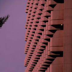 There is a light that never goes out (Arni J.M.) Tags: architecture building pattern lightbulb thereisalightthatnevergoesout sky balconies branch palmtree hotel hiltondubaijumeirahresort jbr dubai uae