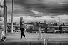 Sit It Out Or Dance (Ian Sane) Tags: ian sane images sititoutordance girl dancing skateboard transportation governor tom mccall waterfront park willamette river downtown portland oregon black white candid street photography canon eos 5ds r camera ef70200mm f28l is usm lens