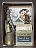 Matchbox still life 6 (Brian L55) Tags: matchbox stilllife surreal knife thimble candlestick cigarattes capstan spade stamp button brass spoon