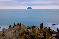 An Islet on the Silky Ocean (milton sun) Tags: islet island hepingisland keelungcity taiwan 基隆和平島 longexposure seascape bay ngc wave ocean shore seaside coast pacificocean landscape outdoor clouds sky water rock mountain rollinghills sea sand beach cliff nature