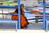 Sitting woman (Dick Verton ( more than 12.000.000 visitors )) Tags: waiting colorful woma pokhara boats