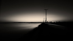 untitled (ChrisRSouthland (back home!! :-) )) Tags: blackandwhite monochrome longexposure water sea powerpole lighttrace invercargill dam nikond800 sunset contraluz zeissdistagon21mmf28 darkness evening eveninglight moody newzealand tripod