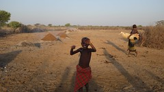 Fighting off tse-tse flies, South Omo, Ethiopia (Michal Przedlacki) Tags: south omo ethiopia hamer dassenech nyangatom mursi karo drought horn africa savannah children suffering water riverbed excavation colour photography livestock climate change tribes clans nature humanitarian childhood crisis