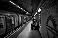 """Some of us laugh, some of us cry"" (Livesurfcams) Tags: kingscross stpancras ricohgr candid tfl london underground londonstreets street movement blackandwhite mono leadingline"