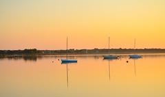 Tethered at sunrise (Lynne Realander Allan) Tags: lynne realander allan bellport ny newyork greatsouthbay bay sunrise dock coast east boats sail calm reflection water