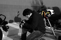 I still wonder how the video is going. (F051) Tags: videographer photographer nikon nikkor bnw blackandwhite blancoynegro highcontrast nikkor18 50mm18 biker motorcycle bike bikes stolenshot stolenmoment