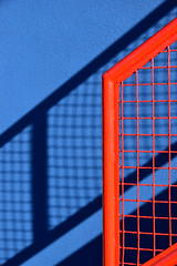 Composition in red and blue (James_D_Images) Tags: red railing stairs blue wall frontlit shadow pattern lines texture colour granvilleisland vancouver britishcolumbia