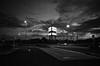 R0000076-Edit.jpg (Michael Schmid) Tags: blackwhite bw black white monochrome ricoh ricohgr grosseto italy tuscany parkinglot space openspace city citylights sky clouds urbanlandscape night dark