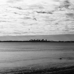 Skyline of Boston (BW Fine Art) Tags: boston leicacameraag massachusetts noiretblanche blackandwhite fineart skyline leicam10 lynn shore coast winter bnw 11 squareframe postcard newengland shoredrive nahantbeach igboston