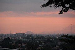Abuja Sunset (Jane Inman Stormer) Tags: pink nigeria africa sunset abuja capitol government dusk evening hill city tree sky mountain