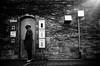 A suspicious person in the morning. (明遊快) Tags: man bw blackandwhite sunlight winter road street door japanese gr2 ivy wall roadblock contrast japan