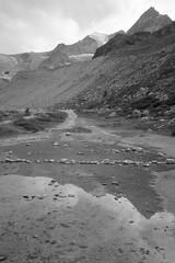 an alpine impression (Riex) Tags: lac lake moraine montagne mountain alps alpes moiry anniviers valdanniviers valais wallis suisse switzerland schweiz bw blackandwhite noiretblanc monochrome g9x
