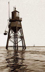 The Chapman Lighthouse, Canvey Island (footstepsphotos) Tags: chapman lighthouse canvey island essex thames estuary sea water structure old vintage photograph past historic early