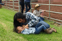 tickles from mom (BarryFackler) Tags: rodeo keikirodeo parkerranch rodeoarena family tickle tickling tickles laugh giggle love fun mom son daughter brother sister smile smiling cowboyhat cowboyboots denim bluejeans flannelshirt joy playing happy child play littlegirl littleboy rope lariat fence lasso paniolo cowboy boy grass hawaii kohala kamuela kamuelahawaii kamuelahi waimea polynesia hawaiiisland hawaiicounty sandwichislands bigisland 2018 hawaiianislands island barryfackler barronfackler