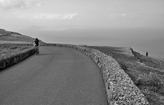 The cyclist (peer.heesterbeek) Tags: cyclist monochrome lanzarote mountain walker