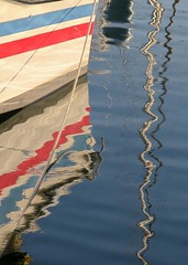 the crooked and the straight (jim_ATL) Tags: boat red blue stripe reflection marina keywest florida