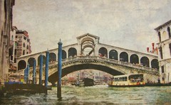Rialto (socalgal_64) Tags: carolynlandi texture italy italia europe history historicalsite ancient old antique stone columns sky pillars buildings structures architecture romanarchitecture venice water river canal bridge rialtobridge rialto boats waterway cityscape explore people tourists watertaxi taxi