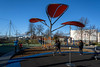 Move To Keep Warm (Jocey K) Tags: newzealand nikond750 southisland christchurch margaretmahyfamilyplayground trees playground sky clouds people buildings