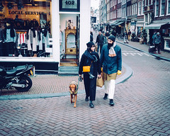 Shopping day (erikvdlinden) Tags: female male twopeople streetphotography winter shopping colorimage couple afternoon walking partner onedog lrthefader adult oneanimal colourimage amsterdam noordholland nederland nl