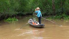 Mekong Taxi (Shawn Harquail) Tags: mekong mekongriver shawnharquail taxi travel vietnam boat lady people river shawnharquailcom water wave
