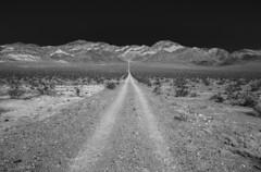 Point A to Point B (JasonCameron) Tags: road tour mountain dirt trail nevada black white monochrome