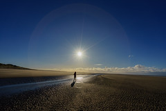 Walker (Adrian Mitu) Tags: nature sea shore seashore irish liverpool ocean sun hallow sky blue scenic silhouette man walking water clouds ray rays light