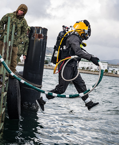 U.S. Navy Divers conduct an underwater pile removal operation at Commander, Fleet Activities Sasebo