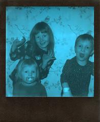 Kids will be kids (Magnus Bergström) Tags: polaroid 680 slr polaroid680slr analog instant film 600 foldable originals polaroidoriginals duochrome black blue blackandblue portrait kids girl boy girls sweden sverige värmland wermland sunnemo laugh laughter smile play children tilber00 alfber00 majber00