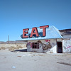 eat. mojave desert, ca. 2016. (eyetwist) Tags: eyetwistkevinballuff eyetwist halloransummit eat logas abandoned diner mojavedesert mamiya 6mf 50mm kodak portra 160 mamiya6mf mamiya50mmf4l kodakportra160 ishootfilm analog analogue film emulsion mamiya6 square 6x6 mediumformat 120 filmexif iconla recentlyprocessedfilm epsonv750pro filmtagger ishootkodak 6 mojave desert california highdesert landscape medium format roadside americana interstate 15 fading weathered arrow sign signgeeks type typography typographic i15 derelict lonely bleak graffiti gasoline gas service station servicestation halloran springs summit palm dead typology american west truckstop ruins