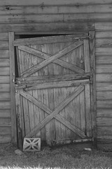 Barn Door (beachinrn) Tags: monochrome blackandwhite door barn oldbarn wood structure crooked offhinge lovethisdoorandtheblockatitsbase