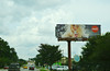 Taste the feeling (radargeek) Tags: driving south usa america thesouth travel traveling roadtrip sky clouds cocacola billboard ad