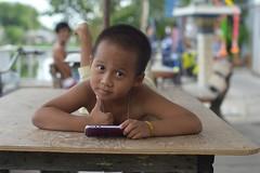 boy with a cellphone (the foreign photographer - ฝรั่งถ่) Tags: jul192015nikon boy table cellphone khlong lat phrao portraits bangkhen bangkok thailand nikon d3200