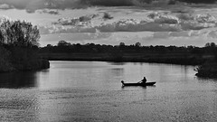 Out fishing (andzwe) Tags: zwolle fishing silhouette darkness lake panasoniclumixdmcgh4 blackandwhite zwartwit monochrome zwolsedijk hasselt dijk vissersboot fishingboat fisher visser somber solitude eenzaamheid fredo godfather thegodfather boat