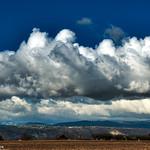 Par delà les champs cultivés, les rudes monts enneigés ardèchois. thumbnail