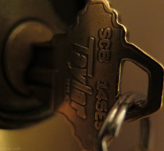 The Key to Happiness (Coyoty) Tags: macromondays lessthananinch macro bokeh flickrfriday thereisnoplacelikehome brown gold metal key home happiness lock reminder numbers bezel letters words numerals digits texture round circle lighting close closeup ring keyring entrance door angle detail