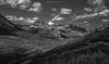 Au Pays du Lautaret (N/B) (Frédéric Fossard) Tags: monochrome noiretblanc blackandwhite landsacpe sky nuages clouds mountain alpage mountainpass coldemontagne cimes crêtes routedemontagne vallée valley coteaux flancdemontagne mountainside mountainpeak mountainrange mountainridge light lumière ombre shadow vallon pierrier nature oisans hautesalpes herbe estive