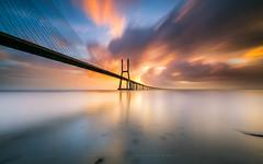 PVG sunrise Félix (marcolemos71) Tags: seascape water hightide bridge pvg concret pontevascodagama sky clouds sunrise storm félix lisbon longexposure leefilters marcolemos