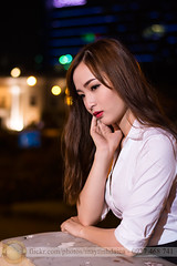 Standing on the balcony at night (Hosting and Web Development) Tags: night lights portrait eyes thinking bokeh dark beautiful white vietnam asia flash young vertical emotion one beauty person woman female arm body face shoulder hair