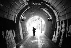 Light at the End of the Tunnel (thedailyjaw) Tags: japan maizuru x100f x100series xseries classicchrome fuji fujifilm tunnel bw blackwhite brick walkway snow winter lamp rain wet dingy silhouette religious spiritual seeingthelight