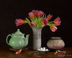Tea time with tulips (Phyllis Freels) Tags: phyllisfreels arrangement brown flowers green pink pottery silver stilllife sugarcubes teapot tulips vase white wood