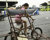 Laughing Girl (Beegee49) Tags: street girl filipina peddling tricycle bacolod city philippines