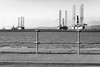mismatch XXXX5543_P0 (the ripped bystander) Tags: blackwhite offshore fence sea disued plant