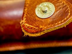 Split seam - Handbag lock - HMM (fotogake) Tags: macromondays imperfection lock leather handbag seam